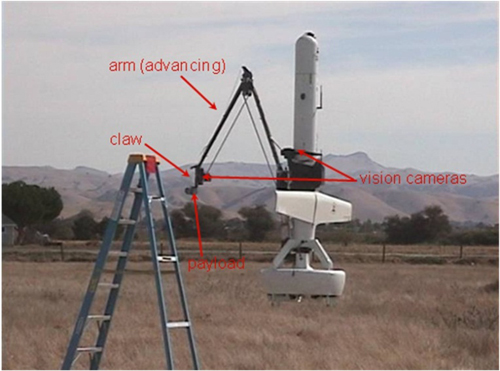 Still-frame from video captured during testing. Here, the arm is advancing with the claw ready to clamp onto the rung of the ladder.