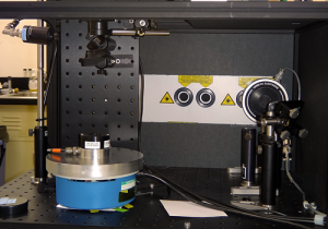 In the traveling SIRCUS setup, the UV beam starts at the bottom right at the shutter. A mirror reflects it diagonally up and to the left until another mirror reflects it down onto the sample stage.