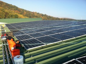 The installation of solar panels on top of the Lichtenberg Tennis Center has become a visible sign of progress in West Point's Net Zero Energy goals. (Photo by Nicole Ciaramella, West Point DPW)