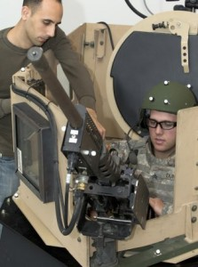 With a newly developed Virtual Environment Test Bed scientists and engineers at the Target Behavioral Research Laboratory at Picatinny Arsenal, N.J., can record how soldiers react and perform inside a newly modified Objective Gunner Protection Kit. (Photo by Todd Mozes)