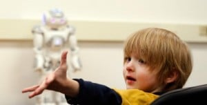 Aiden, who has been diagnosed with ASD, and NAO, the humanoid robot who can help him. (Credit: Joe Howell / Vanderbilt)