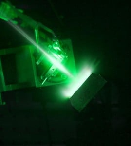 The Vulcan petawatt laser creating plasma with the glow from the electrons clearly visible. (Credit: Photo courtesy of STFC)
