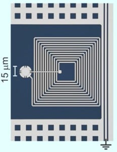 Colorized image of NIST micro-drum and circuit on a sapphire backing. JILA researchers demonstrated that the drum might be used as a memory device in future quantum computers. Credit: Teufel/NIST
