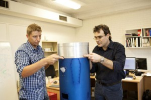 In the early stages of the scramjet's assembly, Dr Sandy Tirtey of UQ and Dr Roberto Gardi of Italian Aerospace Research Centre (CIRA) attach winglets made of a ceramic material which will be tested on its flight in Norway this year.