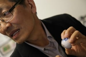 Bioengineering professor Wentai Liu uses a toy eyeball to illustrate the electronic retinal implant that helps restore eyesight to the blind.