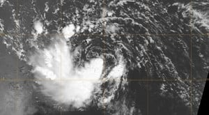 This September 2010 satellite image of Gaston, a one-time tropical storm beginning to fall apart, reveals a misalignment in the storm's circulation. The swirl of low clouds is clearly visible near the center, but circulation higher in the atmosphere is off to the southwest. This misalignment allowed dry air to intrude into the storm, contributing to its demise. (NASA image by the satellite-mounted Moderate Resolution Imaging Spectroradiometer.)