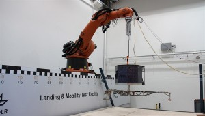 At the DLR Landing and Mobility Test Facility (LAMA) in Bremen, test engineers work with a model of Philae. Here, the probe's landing is simulated on different soils. Credit: DLR