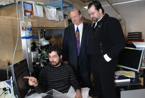"""Ed Boyden, seated, and Joost Bonsen, right, co-teach the class """"Neurotechnology Ventures."""" Rutledge Ellis-Behnke, center, also co-taught the class during its first few years.  PHOTO: DONNA COVENEY"""