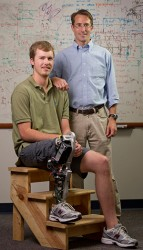 Prof. Michael Goldfarb, right, and Craig Hutto, who lost his lower leg in a shark attack when he was a boy and served as a test subject while the leg was being developed. (John Russell / Vanderbilt )