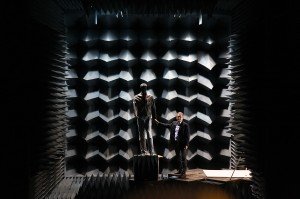 Professor Kamal Sarabandi approaches a mannequin he uses to test his weapons-detecting radar system in an anechoic chamber. His technology could potentially identify a hidden gun or bomb on an approaching person from the distance of a football field away in less than a second. The red dot on the mannequin shows the center of the radar beam, but it can gather information about objects hidden on the subject's torso. Photo by Marcin Szczepanski/Multimedia Producer, University of Michigan, College of Engineering