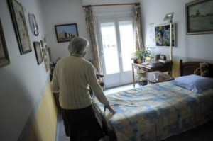 A woman walks in her room on March 18, 2011 in Angervilliers, eastern France. A new way for families to stay close to independent elders that blends modern technology with old fashioned parcel post debuted on crowd-funding website Kickstarter Tuesday.