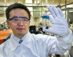 Berkeley Lab's Samuel Mao used disorder engineering to transform titanium nanocrystals into highly efficient solar hydrogen photocatalysts, a transformation marked by turning the crystals from white to black. Credit: Roy Kaltschmidt