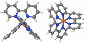 Sticks and balls model of the transition metal complex iron(II)-tris-bipyridine [Fe(bpy)3]2+. Iron-atoms (Fe) are brown, nitrogen (N) blue, carbon grey, and hydrogen (H) white. The six nitrogen atoms are at the corners of an octahedron around the Fe atom. The planes of the 3 bipyridine subunits (N2C10H8) are mutually perpendicular. Credit: MBI