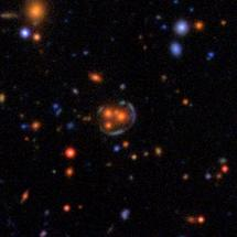Spotting a space warp (centre) in an image of thousands of other galaxies is tricky [Image: Space Warps Collaboration/CFHT/Terapix]