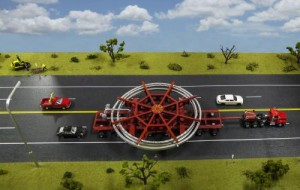 A model of the truck that will be used to transport the Muon g-2 ring, placed on a streetscape for scale. The truck will be escorted by police and other vehicles when it moves from Brookhaven National Laboratory in New York to a barge, and then from the barge to Fermi National Accelerator Laboratory in Illinois. Credit: Fermilab