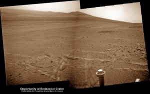 Opportunity pops a 'wheelie' on Mars on May 15, 2013 (Sol 3308) and then made history by driving further to the mountain ahead on the next day, May 16 (Sol 3309), to establish a new American distance driving record for a vehicle on another world. This navcam mosaic shows the view forward to Opportunity's future destinations of Solander Point and Cape Tribulation along the lengthy rim of huge Endeavour crater spanning 14 miles (22 km) in diameter. See below our complete map of the 9 Year Journey of Opportunity on Mars. Credit: NASA/JPL/Cornell/Ken Kremer /Marco Di Lorenzo