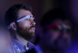 "A man wearing Google Glass eyewear attends the Google I/O developers conference in California on May 15, 2013. Many of the 6,000 developers attending the annual event sported Glass as part of an ""explorer"" program to tinker with creative applications."