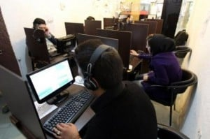 Iranians surf the net at a cyber at a cafe in Tehran on in 2011. Iran is tightening control of the Internet ahead of next month's presidential election, mindful of violent street protests that social networkers inspired last time around over claims of fraud, users and experts say.