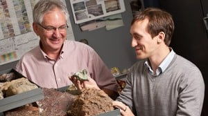 Geosciences professor John Isbell (left) and postdoctoral researcher Erik Gulbranson look over some of the many samples they have brought back from Antarctica. The two are part of an international team of scientists investigating the last extreme climate shift on Earth, which occurred in the late Paleozoic Era. (Photos by Troye Fox)