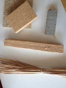 Cattail (Typha) in various stages of processing. The insulation panel is shown above right. (© Fraunhofer IBP)
