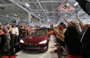 In this June 22, 2012 file photo, Tesla workers cheer on the first Tesla Model S cars sold during a rally at the Tesla factory in Fremont, Calif. The Tesla Motors Inc. Model S electric car has tied an older Lexus for the highest score ever recorded in Consumer Reports magazine's automotive testing on Thursday, May 9, 2013. (AP Photo/Paul Sakuma, File) Read more at: http://phys.org/news/2013-05-tesla-consumer-score.html#jCp
