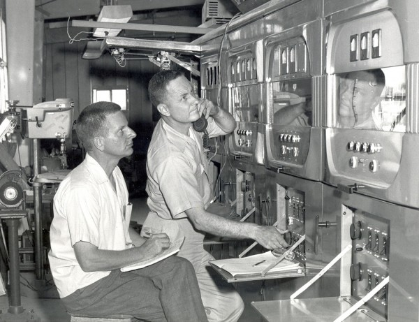 Then: Engineer David Andrews and technician Robert Oase are shown by the WWVB transmitter in 1963. Oase is relaying instructions to an engineer in a different location tuning the antenna. Credit: NIST
