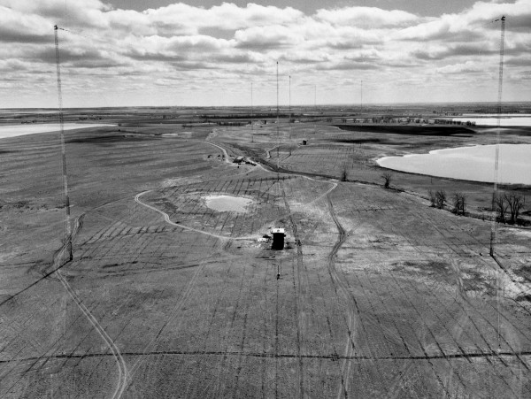 This 1963 photo of NIST's then-new radio station in Fort Collins, Colo., was taken from one of four towers supporting an antenna. The small building in the foreground is the helix house, which contained equipment to electrically match the station's transmitter to the antenna. Credit: NIST