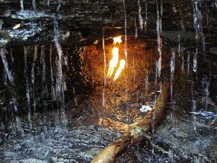 "The ""eternal flame"" in Erie County, N.Y., shines through a waterfall."