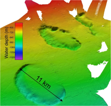 Three dimensional seabed map of Chatham Rise displays two pockmark features, each approximately 10 kilometers in diameter, on the southern flank of the Chatham Rise seafloor. Water depth, in meters, is indicated in the legend on left.