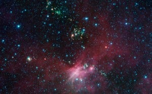 Dozens of newborn stars sprouting jets from their dusty cocoons have been spotted in images from NASA's Spitzer Space Telescope. Image credit: NASA/JPL-Caltech/University of Wisconsin