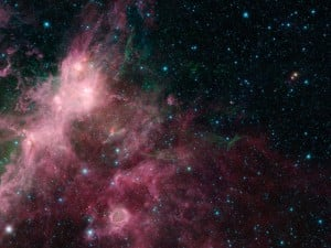 In what may look to some like an undersea image of coral and seaweed, a new image from NASA's Spitzer Space Telescope is showing the birth and death of stars. Image credit: NASA/JPL-Caltech/University of Wisconsin