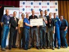 A NASA Centennial Challenges first prize, level one, check is presented to team Survey for successfully completing level one of the NASA 2013 Sample Return Robot Challenge. (NASA/Bill Ingalls)