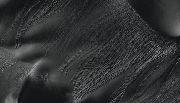 "Several types of downhill flow features have been observed on Mars. This image from the High Resolution Imaging Science Experiment (HiRISE) camera on NASA's Mars Reconnaissance Orbiter is an example of a type called ""linear gullies."" Image credit: NASA/JPL-Caltech/Univ. of Arizona"