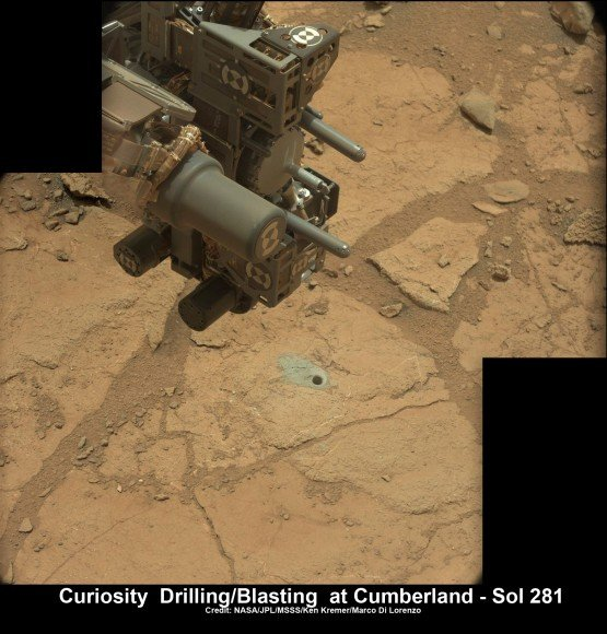 Curiosity's hi tech 'hand' and percussion drill hovers above 2nd bore hole at Cumberland mudstone rock after penetrating laser blasting to unlock secrets of ancient flow of Martian water. Note the row of small pits next to the 0.6 inch (16 mm) diameter hole. Photo mosaic assembled from high resolution Mastcam images on May 21, 2013, Sol 281. Credit: NASA/JPL-Caltech/MSSS/Ken Kremer (kenkremer.com)/Marco Di Lorenzo