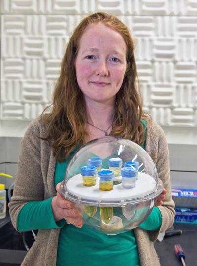 Katy Keenan holds a diffusion phantom made by colleague Michael Boss.
