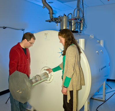 Karl Stupic and Katy Keenan place a sample in the new 7 tesla small-bore MRI unit.