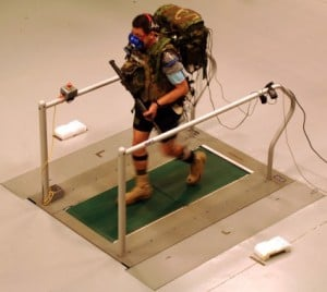 A soldier carries a 61-pound load while walking in a prototype DARPA Warrior Web system during an independent evaluation by the U.S. Army. (Photo provided by DARPA)