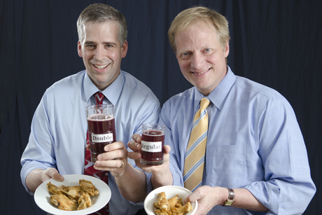 David Just, left, and Brian Wansink have co-authored a study that shows that whether foods are labeled small, regular or double-sized influences how much people will consume – and how much they'll pay for them. Credit: Robyn Wishna