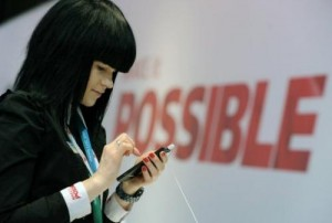 This file photo shows a hostess holding a Huawei smartphone at the 2013 Mobile World Congress in Barcelona, on February 28, 2013. Chinese telecoms giant will launch a new smartphone on Tuesday to better compete with high-end rivals like Apple and Samsung overseas, according to a company official.