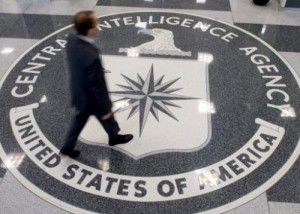 A man crosses the Central Intelligence Agency (CIA) logo in the lobby of CIA Headquarters in Langley, Virginia, on August 14, 2008. The CIA selected Amazon over IBM to build a cloud computing service for the spy agency even though IBM's proposal carried a lower price tag, according to a government report.