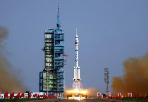 A Shenzhou-9 rocket blasts off from the Jiuquan space base, northwest China's Gansu province in the remote Gobi desert on June 16, 2012. China will launch three astronauts into space this month to dock with an experimental space-module, state-media said, marking the latest step towards the country's aim of building a space station.
