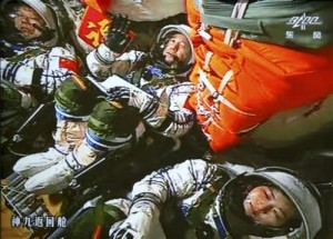 In this June 16, 2012 file image made off the monitor screen at the Beijing Aerospace Flight Control Center and released by China's Xinhua News Agency, China's astronauts Jing Haipeng, center, Liu Wang, left, and Liu Yang sit inside the capsule after the launch of China's manned Shenzhou-9 spacecraft. China's astronauts have braved the tension of docking with a space station and performed delicate tasks outside their orbiting capsule, but now face a more down-to-Earth job that is perhaps equally challenging: Talking to young people about science. Coming on the heels of Canadian astronaut Chris Hadfield's wildly popular YouTube videos from the International Space Station, the three astronauts aboard China's latest mission, expected to launch early June 2013, plan to deliver a series of talks to students from aboard China's Tiangong 1 space lab.(AP Photo/Beijing Aerospace Flight Control Center via Xinhua, File)