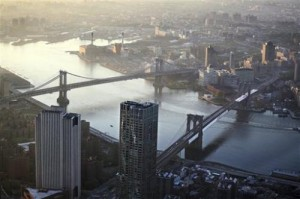 This May 10, 2013 file photo shows view of the Manhattan Bridge, left, and Brooklyn Bridge as seen from the 105th floor of One World Trade Center, in New York. Seven months after Superstorm Sandy swamped New York, Mayor Michael Bloomberg proposed a nearly $20 billion plan Tuesday, June 11, 2013, to protect the city from the effects of global warming and storms. (AP photo/Mark Lennihan, File)