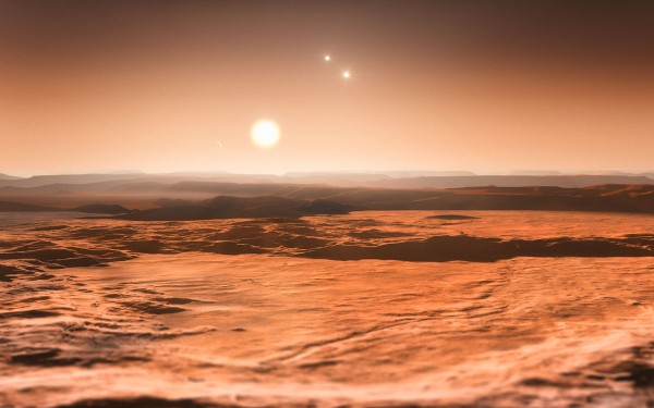 This artist's impression shows the view from the exoplanet Gliese 667Cd looking towards the planet's parent star (Gliese 667C). In the background to the right the more distant stars in this triple system (Gliese 667A and Gliese 667B) are visible and to the left in the sky one of the other planets, the newly discovered Gliese 667Ce, can be seen as a crescent. A record-breaking three planets in this system are super-Earths lying in the zone around the star where liquid water could exist, making them possible candidates for the presence of life. This is the first system found with a fully packed habitable zone.