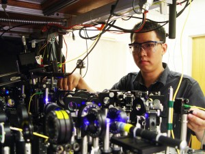 Entanglement with Light Georgia Tech graduate student Lin Li adjusts the optics on equipment being used to measure the entanglement between light and an optical atomic excitation in the laboratory of Alex Kuzmich. (Photo: Kuzmich Physics Lab)