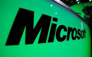 Microsoft logo is seen during the Electronic Entertainment Expo in Los Angeles, California, on June 7, 2011. Microsoft says it has teamed with the FBI to disrupt armies of hacked computers used to commit more than a half-billion dollars in financial fraud around the world.