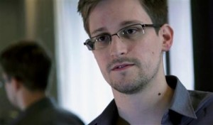 This June 9, 2013 photo provided by The Guardian newspaper in London shows Edward Snowden, who worked as a contract employee at the U.S. National Security Agency, in Hong Kong. The Guardian newspaper says that the British eavesdropping agency GCHQ repeatedly hacked into foreign diplomats' phones and emails when the U.K. hosted international conferences, even going so far as to set up a bugged Internet café in an effort to get an edge in high-stakes negotiations. The Guardian cites more than half a dozen internal government documents provided by former NSA contractor Edward Snowden as the basis for its reporting on GCHQ's intelligence operations. (AP Photo/The Guardian, File)