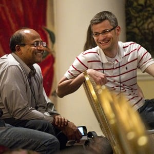 Bjoern Schenke, right, chats with fellow Brookhaven Lab nuclear theorist Raju Venugopalan, at last summer's Quark Matter meeting in Washington, D.C. Schenke recently won a Young Scientist Prize in nuclear physics from the International Union of Pure and Applied Physics.