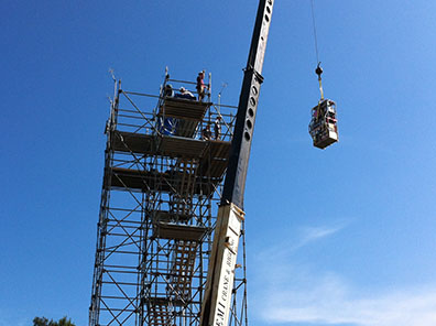 A team hoists 500 pounds of instrumentation belonging to Pennsylvania State University to the top of a 75-foot chemistry sampling tower at a SAS field project site in Brent, Alabama. (©UCAR, Photo by Jim Moore)