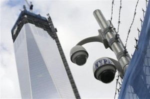 In this Monday, Feb. 25, 2013, file photo, New York Police Department security cameras are in place at the National September 11 Memorial and Museum, in New York. Since Sept. 11, 2001, Americans' expectations of privacy have diminished remarkably. Laws were passed to take up the fight against terrorists by giving authorities access to information that previously was off limits and technologies have made it easier for corporations to track their movements and habits. (AP Photo/Mark Lennihan)